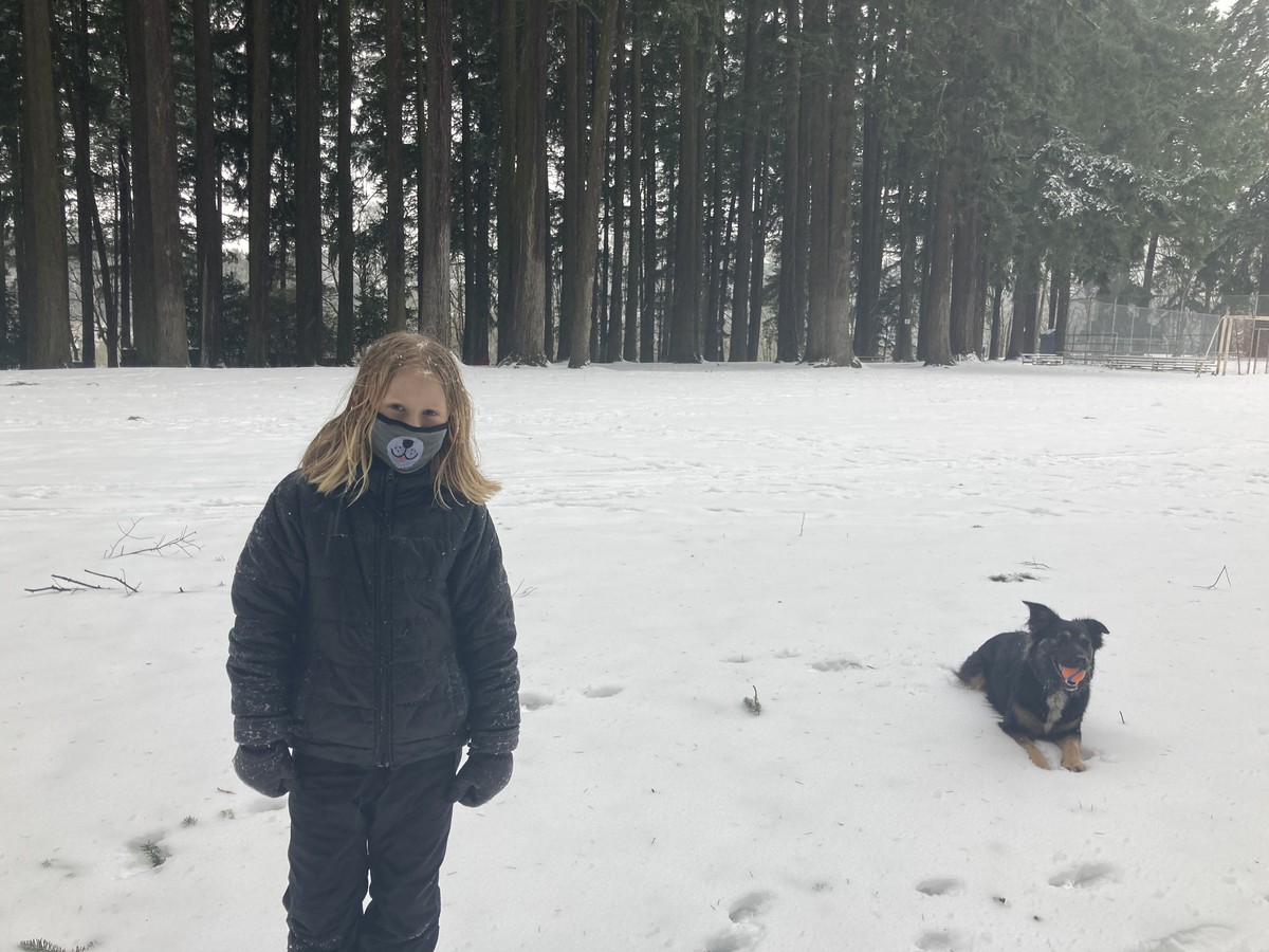 Ada and Kuma in the snow at the park
