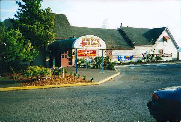 "Scan of old photo of ""Who-Song and Larry's"" parking lot & restaurant"
